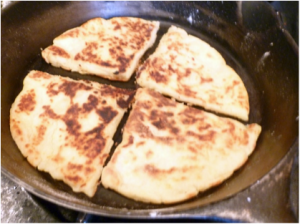 Frying potato farls, from http://howtofood.net/2011/11/07/farls-irish-potato-bread/